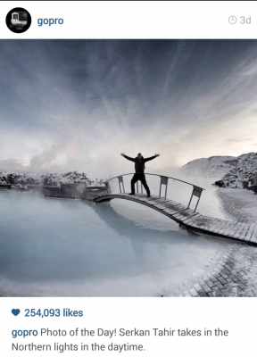 GoPro Instagram man on an icy bridge. Photo of the day. Serkan Tahir takes in the Northern lights in the daytime.
