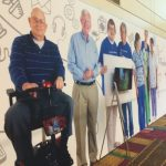 Wall of senior residents with staff members.