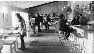 Black and white photo of people in a restaurant